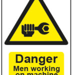 Danger Men Working On Machine
