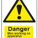 Danger Men Working On Apparatus
